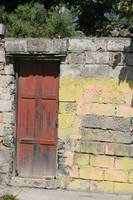 Red Door in a Yellow Wall