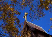 Golden Cross and Autumn Leaves