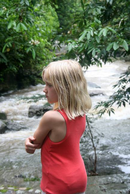 Young Girl Looking Over a River