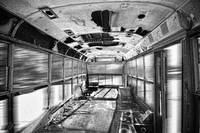 Old Rusty School Bus In Motion BW