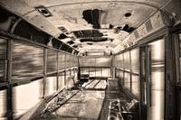 Old Rusty School Bus In Sepia Motion
