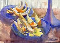 blue plate with orange peels