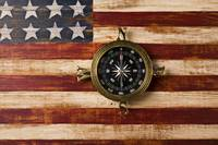 Compass on wooden folk art flag