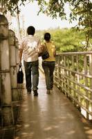 Couple crossing bridge