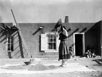 Tewa Woman Winnowing Wheat