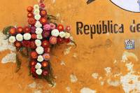Wreath against Peeling Paint Orange in Guate