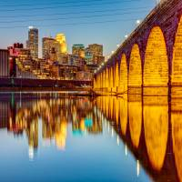 """Stone Arch Bridge and Minneapolis Skyline at Dusk"" by GregLundgrenPhotography"