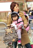Fierce Oca-San Cyclist, Not So Convinced Toddler