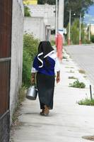 Indigenous Woman Carrying a Jug