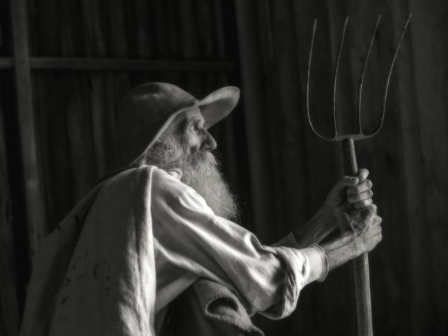 Old Farmer with Pitchfork