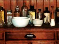 Cabinet With Mortar and Pestles