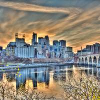 """""""Minneapolis Riverfront and Stone Arch Bridge"""" by GregLundgrenPhotography"""