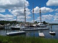Schooners and Sailboats Are Docked In The Harbor