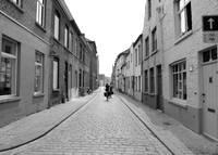 Biking in Bruges - Black and White by Carol Groenen