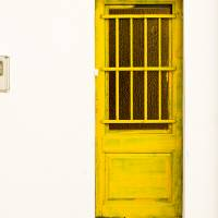 Yellow Door Of Catalunya Spain Art Prints & Posters by Calvin Hanson