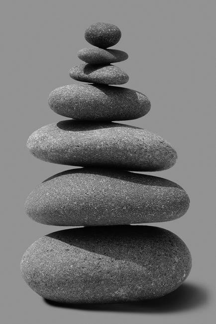 Stacked River Rocks On Grey Background By Morgan Howarth