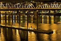 Hawthorne Bridge and People at Night In Portland,