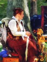 Woman Spinning Yarn at Flea Market