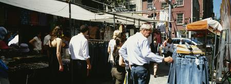 Group of people shopping in a market