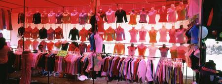 Clothes hanging in a market stall