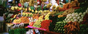 Assorted fruits and vegetables on a market stall