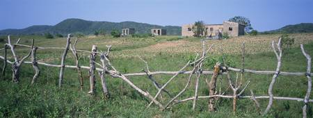Wooden fence in a field