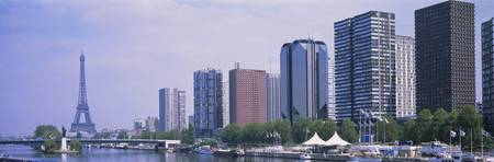 Skyscrapers at the waterfront with a tower in the