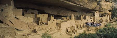 High angle view of tourists at cliff dwellings
