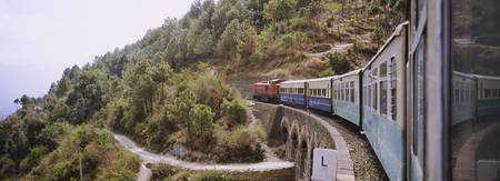 Toy train passing over a bridge