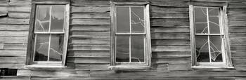 Low angle view of the windows of a log cabin