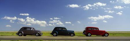 Three Hot Rods moving on a highway