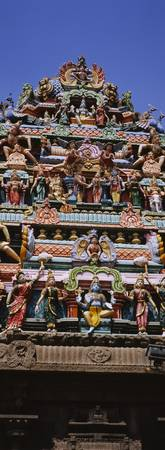 Low angle view of statues of Hindu gods on the ro