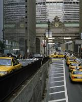 Yellow taxis on road viewed from Park Avenue tunn