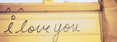 Close-up of I love you written on a wall