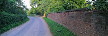 Brick Wall and Curved Road UK