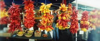 Strands of chili peppers hanging in a market stal