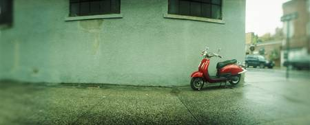 Scooter parked near a building Williamsburg Brook