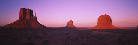 Rock formations on an arid landscape at dusk