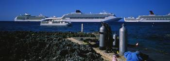 Diving equipment at the coast with cruise ships i