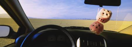 Desert viewed through windshield of a car