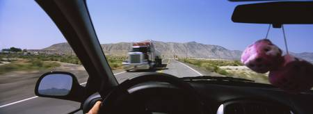 Truck on a highway viewed through windshield of a