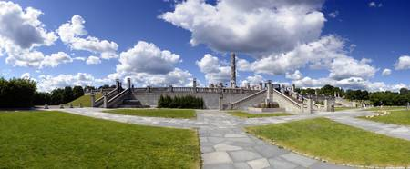 Tourists in a park The Monolith Gustav Vigeland S