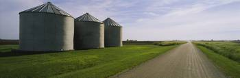 Three silos in a field