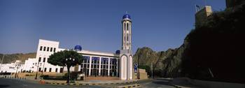 Building with a minaret near mountain Muscat Oman