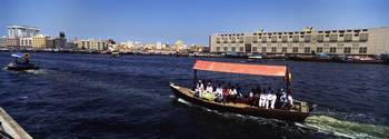 People traveling in a boat Dubai Creek Dubai Unit