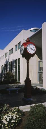 Clock in front of a university building