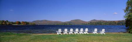 Group of lounge chairs near a lake