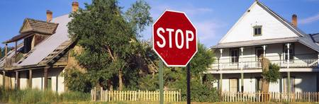 Stop sign in front of a house