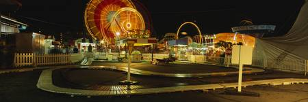 Amusement park lit up at night