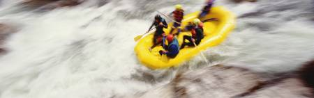High angle view of four people rafting in a river